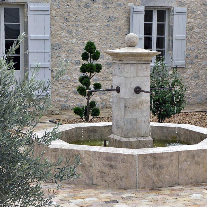 fontaine en pierre de taille avec bassin octogonal